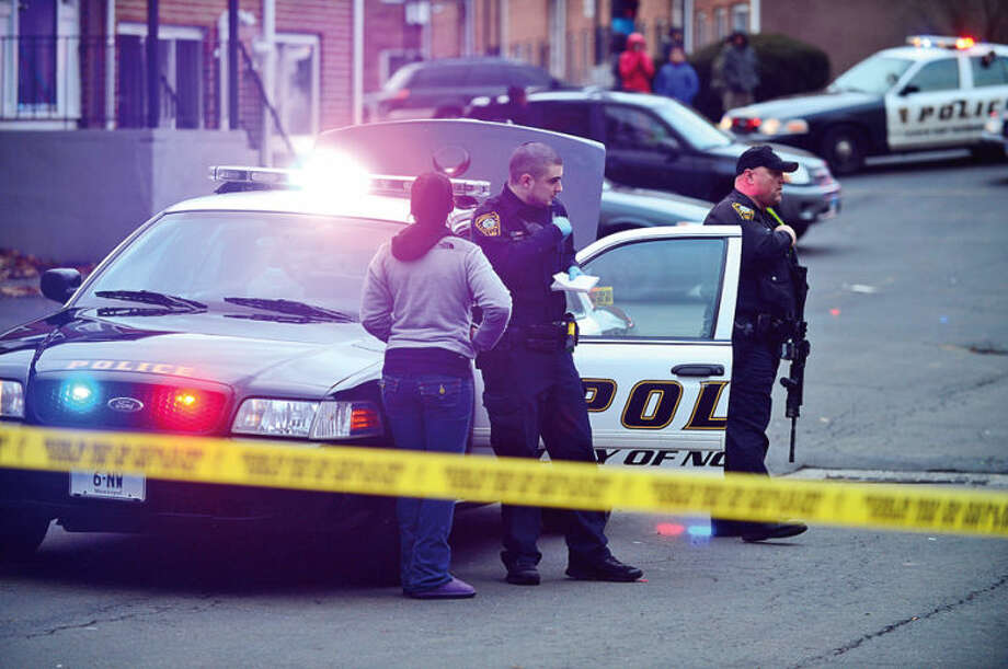 Hour photo / Erik Trautmann Norwalk police investigate a shooting at Monterey Village Tuesday evening.