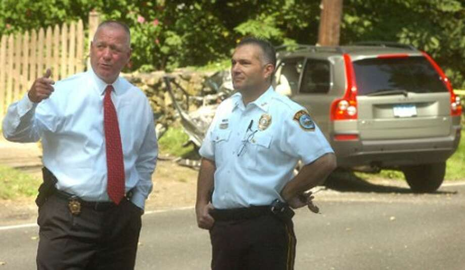 Photo/Alex von Kleydorff. Westport Police Chief Alfred Fiore and Wilton''s acting Chief Michael Lombardo at the scene of a fatal car jacking crash in Weston center Tuesday morning.