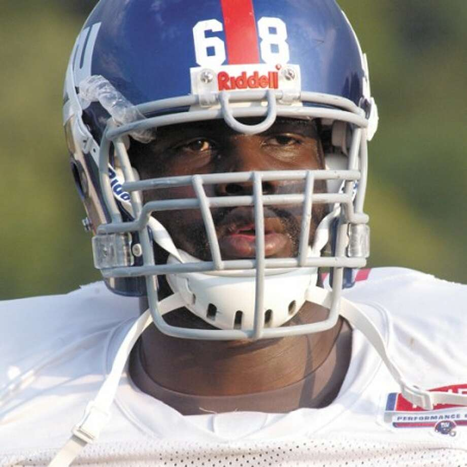 Hour Photo/John Nash - Cliff Louis, a product of Westhill High School, is working as hard as he can trying to make the roster of the New York Giants.
