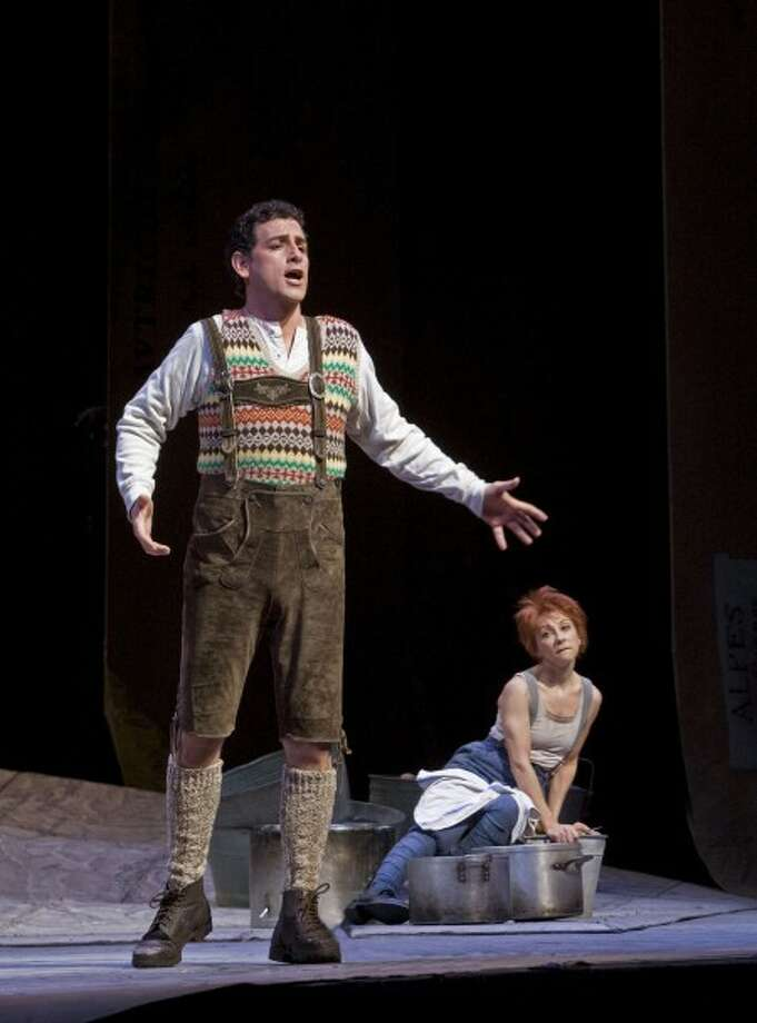 "In this photo provided by the Metropolitan Opera, Peruvian tenor Juan Diego Florez, sings in the role of the lovesick Tonio opposite French soprano Natalie Dessay, right, in the role of Marie, the tomboy title character in a scene from Donizetti''s ""La Fille du Regiment"" (""The Daughter of the Regiment"") with during the final dress rehearsal in New York on Friday, April 18, 2008, at the Metropolitan Opera. (AP Photo/Metropolitan Opera, Ken Howard)"