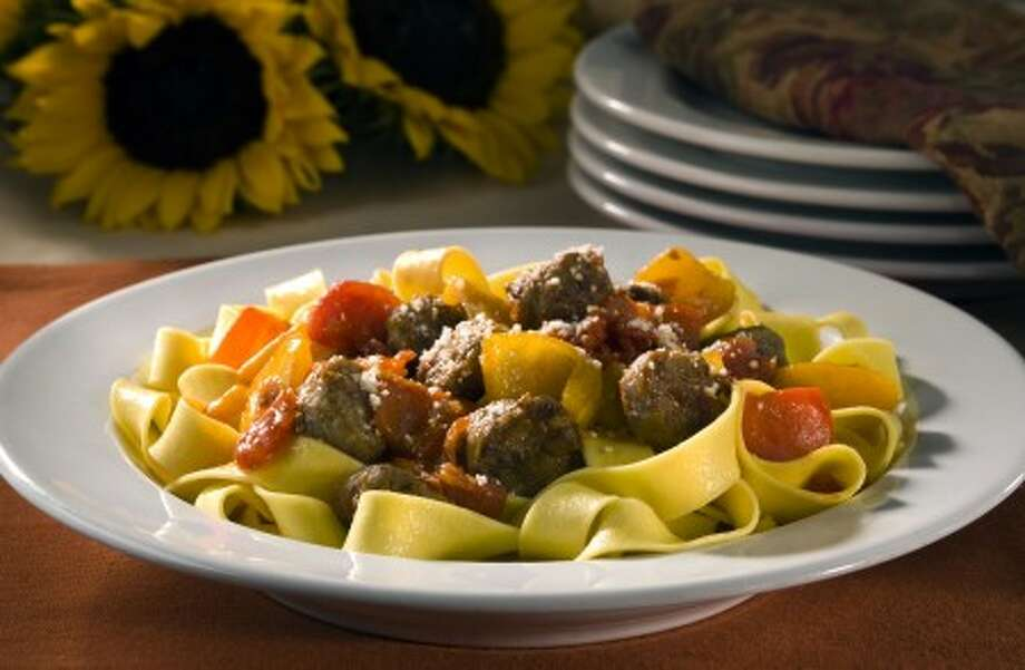 Red and yellow peppers team up with sausage for a delicious sauce over pasta. AP photo