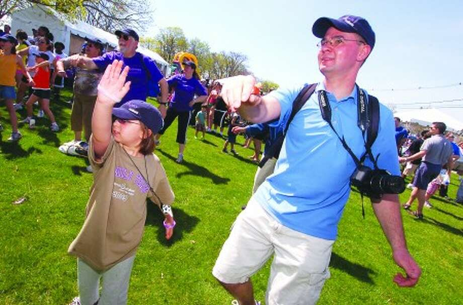 Photo/Alex von kleydorff. 7 yr old Anna gets warmed with with dad Martin Malin for The March of Dimes , March for Babies at Calf Pasture Beach. The Malin''s, including mom Crystal and daughter 5yr old Ellie are the Ambassador family for this event.