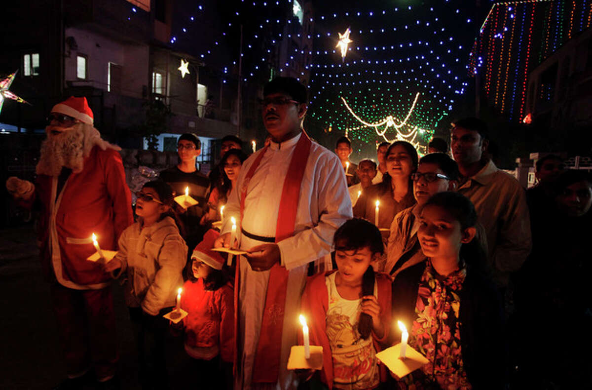 Indian Christians hold candles ahead of Christmas in Ahmadabad, India, Tuesday, Dec. 24, 2013. Though Hindus and Muslims comprise the majority of the population in India, Christmas is celebrated with much fanfare. (AP Photo/Ajit Solanki)