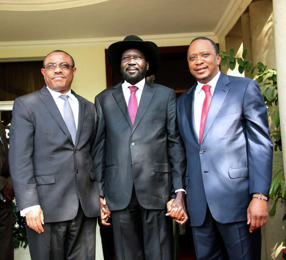 In this photo released by the Kenyan Presidential Press Service, Ethiopian Prime Minister Hailemariam Desalegn, left, South Sudanese President Salva Kiir, center, and Kenyan President Uhuru Kenyatta, right, pose for a photos before their meeting at State House in Juba, South Sudan, Thursday, Dec. 26, 2013. The leaders of Kenya and Ethiopia arrived in South Sudan on Thursday to try and mediate between the country's president and the political rivals he accuses of attempting a coup that the government insists sparked violence threatening to destroy the world's newest country. (AP Photo/Kenyan Presidential Press Service) / Kenyan Presidential Press Service