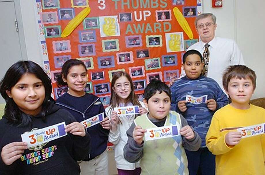 Brookside Elementary school Principal, David Hay with students, Olivia Rosado, Alexapamela Quesada, Maria Curndari, Hector Ayala, Daniel Joseph and Anthony Bombace. The school was named 2008-09 Success Story School by ConnCan.