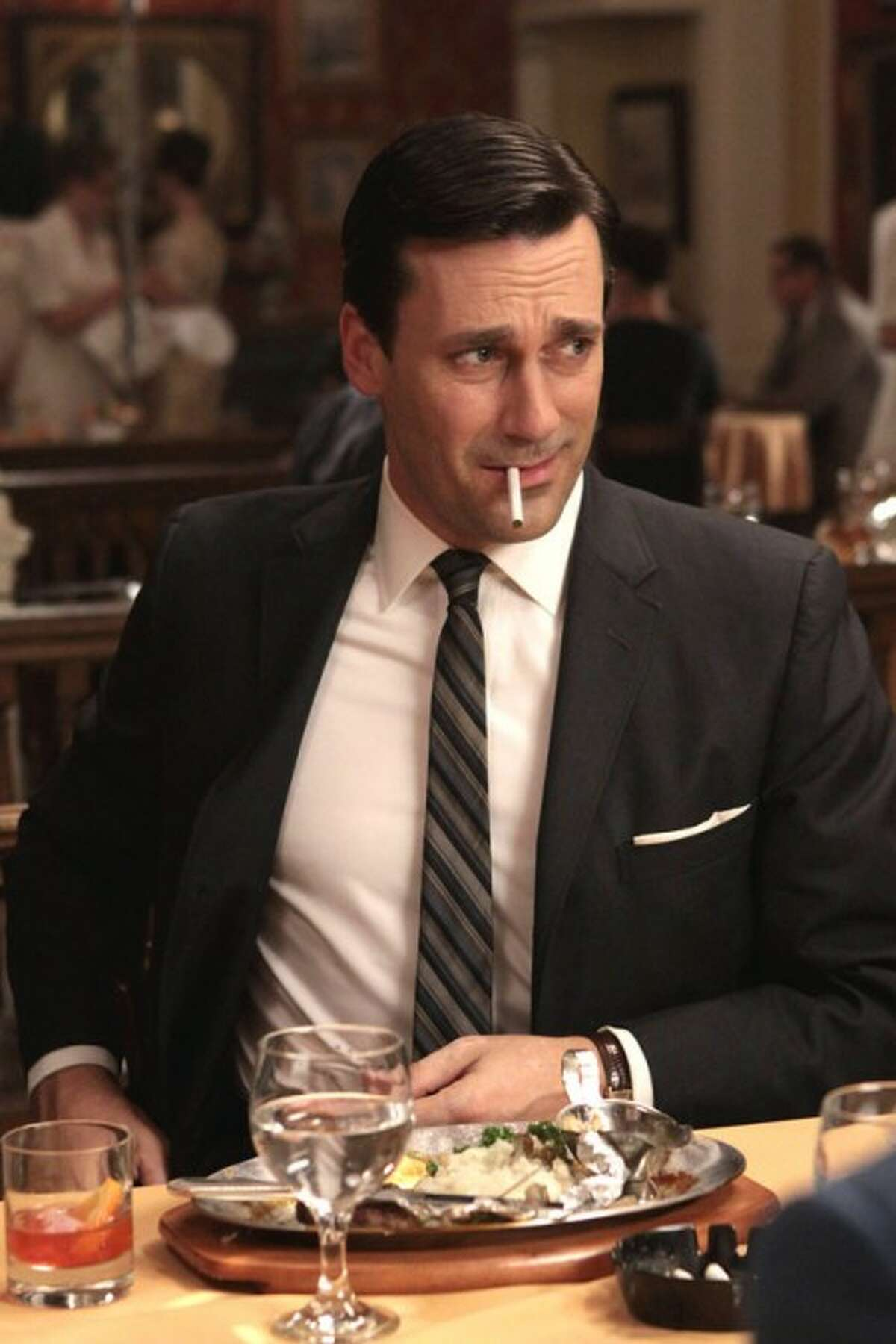 In this publicity image released by AMC, Jon Hamm portrays Don Draper in the AMC series,