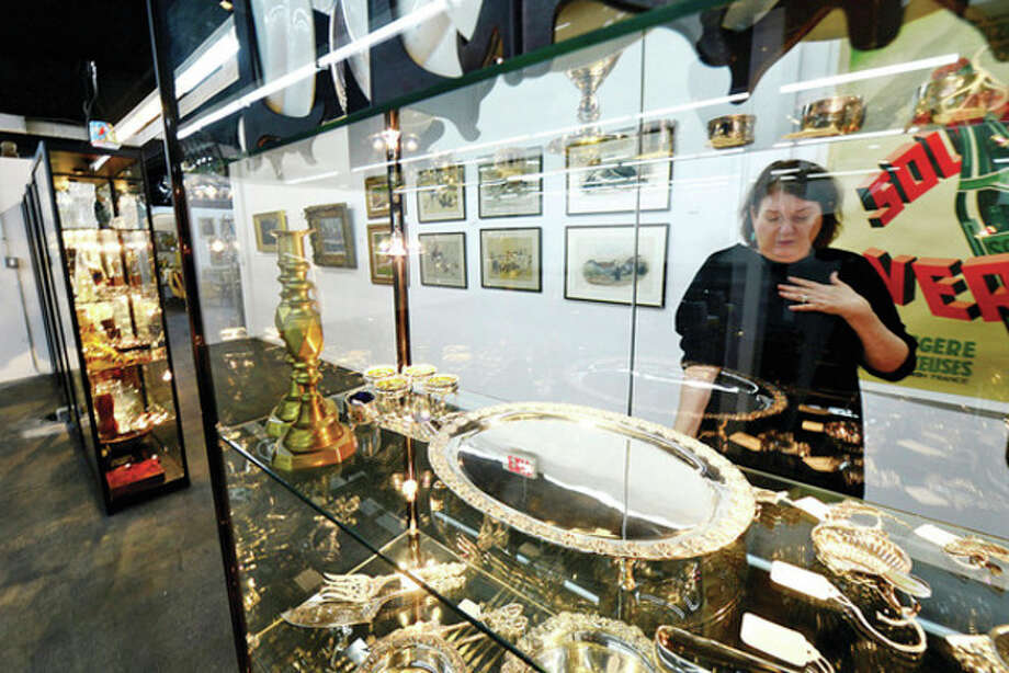 Hour photo / Erik TrautmannBarbara March, Sales and Marketing Manager at the new Antique and Design Center on Willard Ave. looks over some of the antique silver in the facilty that opened Dec. 15 with over 100 vendors. / (C)2013, The Hour Newspapers, all rights reserved