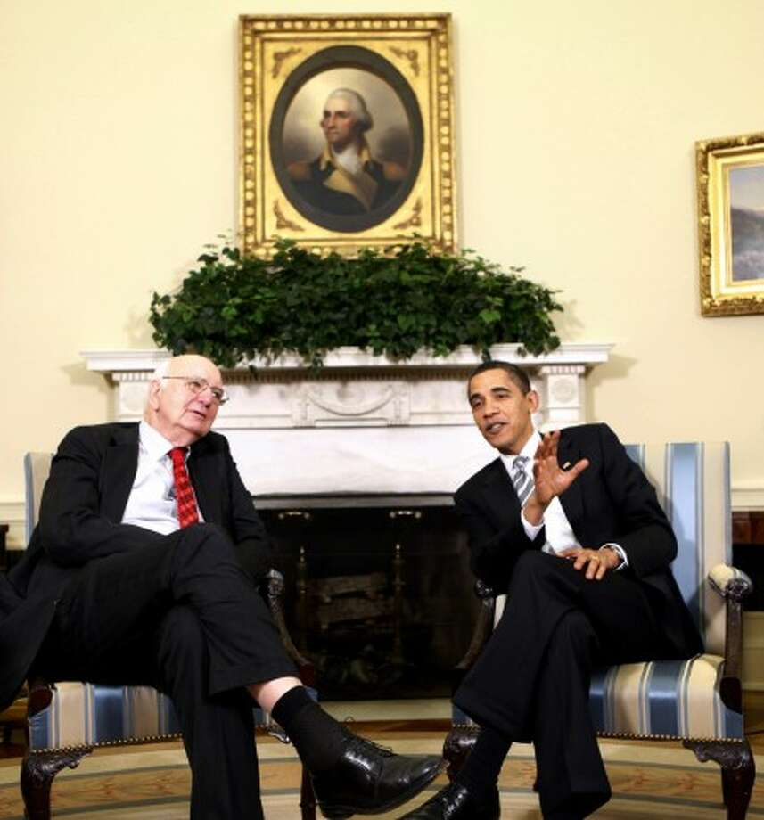 President Barack Obama, accompanied by Economic Recovery Advisory Board Chairman Paul Volcker, makes remarks in the Oval Office of the White House in Washington, Friday, March 13, 2009. (AP Photo/Gerald Herbert)