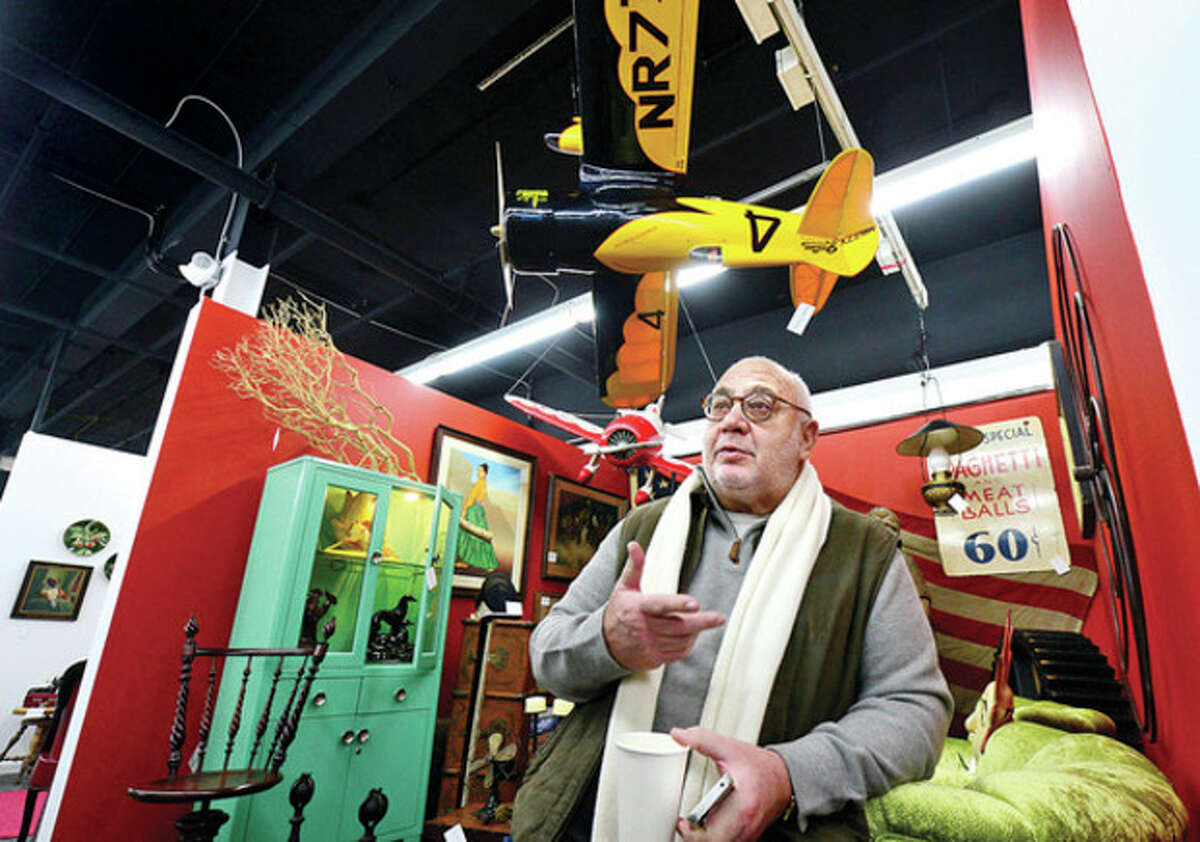 Hour photo / Erik Trautmann Tom Roth, who owns Montage Antiques in Westport, is one of the over 100 vendors at the new Antique and Design Center on Willard Ave that opened Dec. 15.