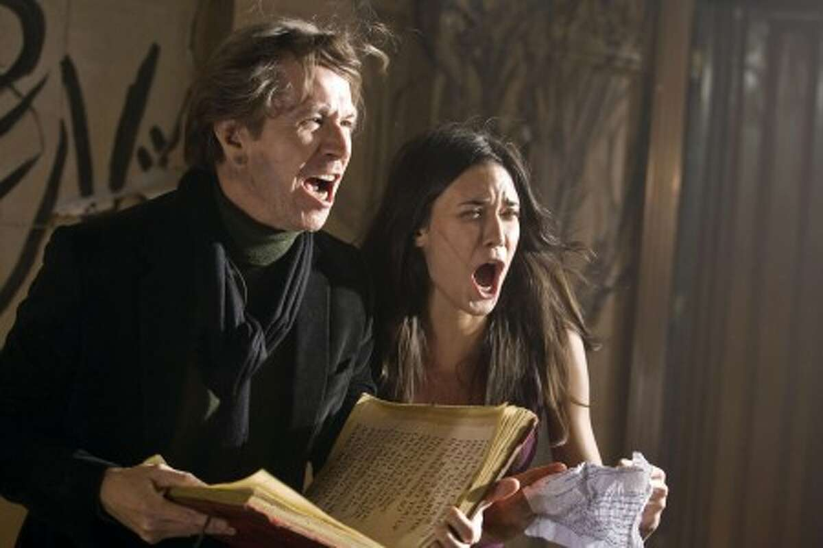 Gary Oldman and Odette Yustman in a scene from the supernatural thriller,
