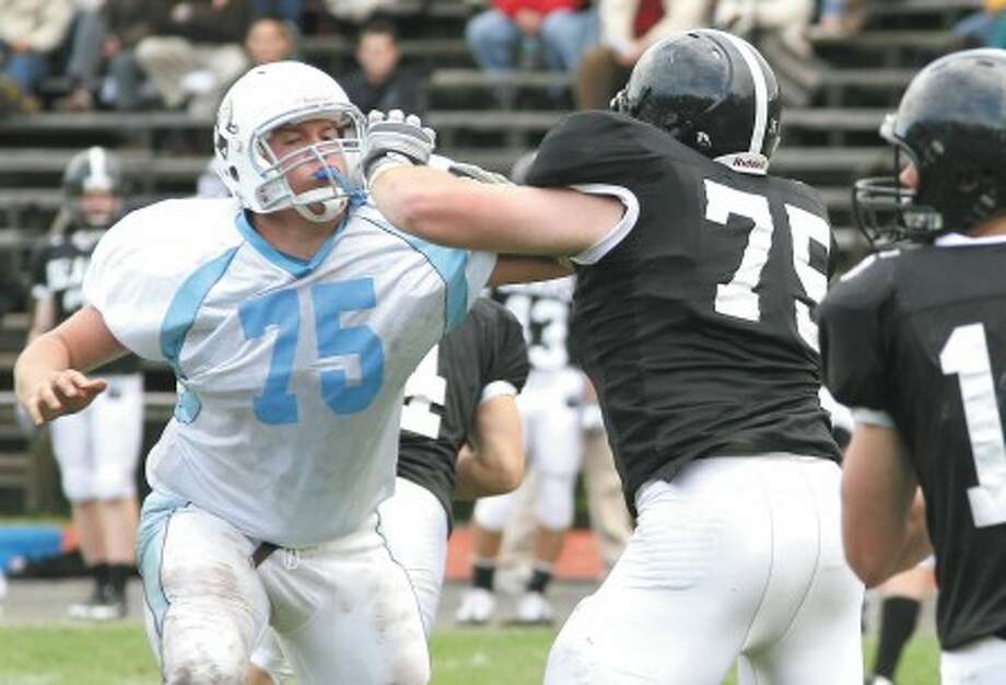 Contributed photo - Tufts Dan Stebbins, left, and Bowdoin''s Joe Smith do battle last Saturday in Brunswick, Maine.