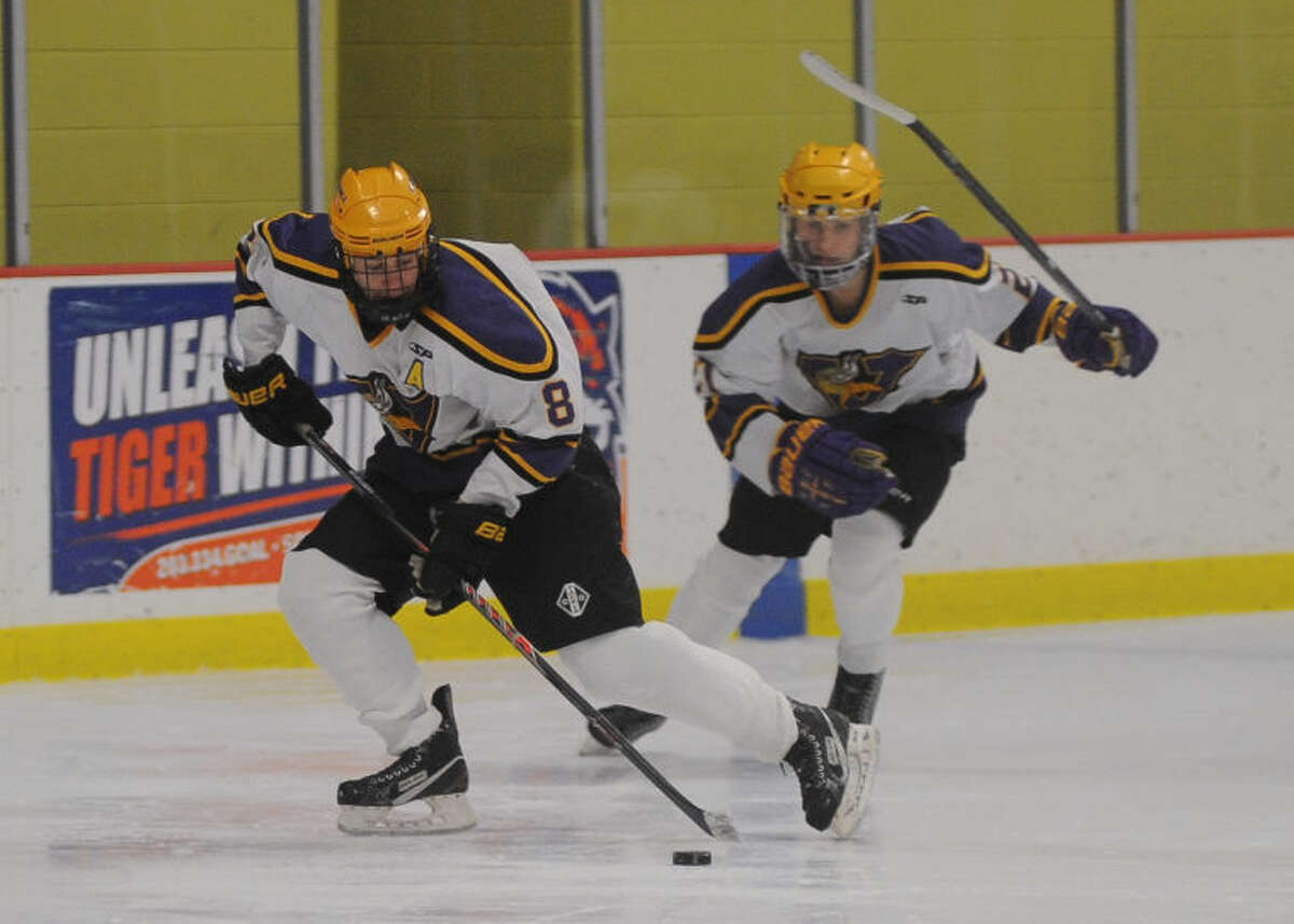 Hour photo/John Nash - Westhill's Ryan Silk, front, and Joshua Mensah, left, rush up ice during Thursday's high school boys hockey game against Stamford at Terry Conners Rink. Westhill topped Stamford, 6-3.