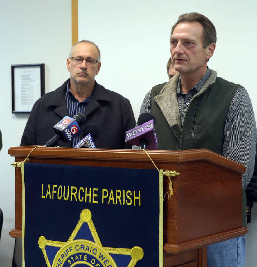 Lafourche Parish Sheriff Craig Webre, right, speaks during a news conference Thursday evening, in Lockport, La., after 38-year-old Ben Freeman went on a shooting rampage in four locations in two parishes in south Louisiana. Authorities say Freeman was embroiled in a custody fight with his ex-wife. He killed himself after attacking his current wife, his former in-laws and his onetime boss at a hospital that fired him. (AP Photo/The Daily Comet, Abby Tabor)