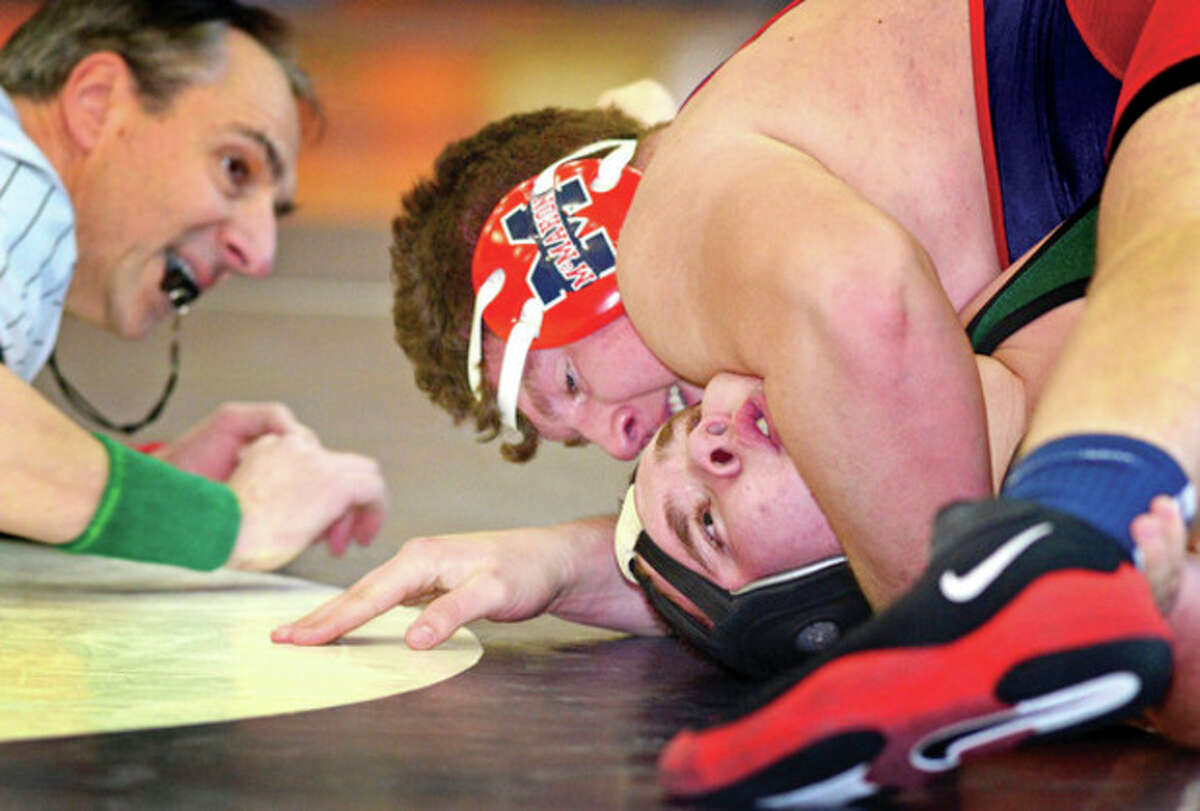 Hour photo/Erik Trautmann Brien McMahon's Andrew Starr, top, pins Norwalk's Doug Knowles during Friday's clash of the crosstown rivals at Brien McMahon High School.