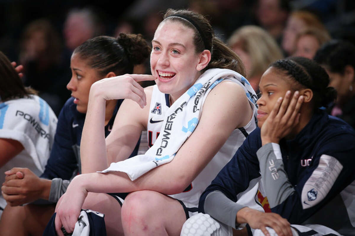 Connecticut forward Breanna Stewart, center, smiles on the bench during the second half of an NCAA college basketball game against California as part of the Maggie Dixon Basketball Classic at Madison Square Garden, Sunday, Dec. 22, 2013, in New York. Connecticut defeated California 80-47. (AP Photo/John Minchillo)