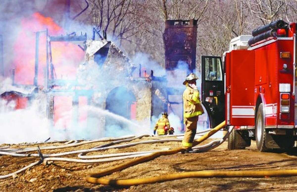 Weston firefighters battle a blaze that destroyed a home on Smith Ridge Rd. Tuesday. Hour photo / Erik Trautmann