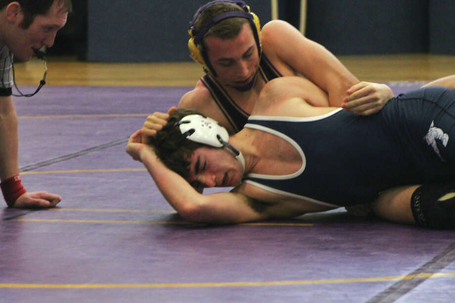 Photo by Joe RyanWesthill's Krzysztof Mazur, top, goes for the pin against Jake Santo of Staples during Friday's match.