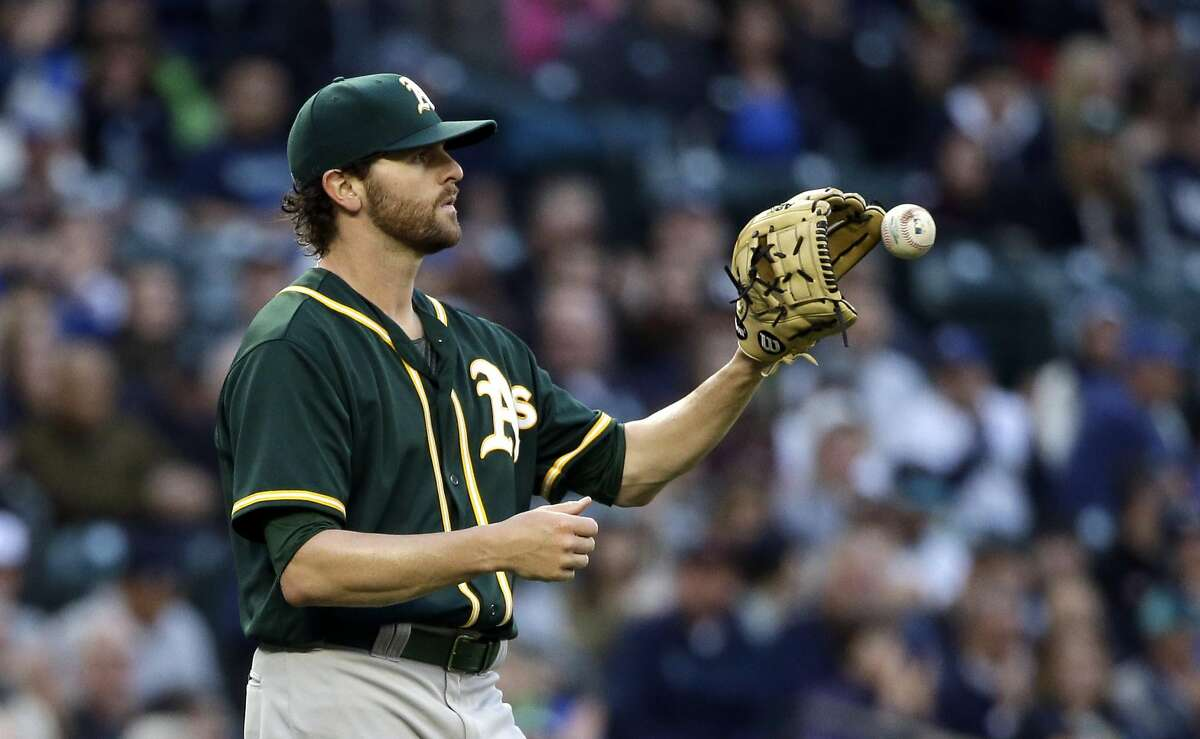 Oakland Athletics starting pitcher Zach Neal gets the ball back against the Seattle Mariners in a baseball game Wednesday, May 25, 2016, in Seattle. (AP Photo/Elaine Thompson)