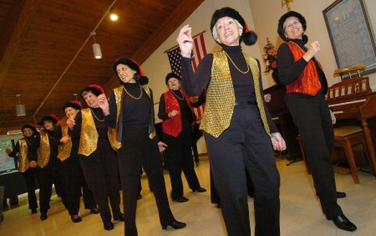 Photo/Alex von Kleydorff. The Trebblemakers are in step for a Holiday Sing a long at Ogden House.
