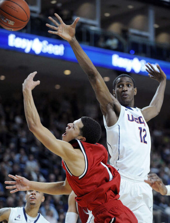 Eastern Washington's Tyler Harvey (1) drives past Connecticut's Kentan Facey (12) during the first half of an NCAA college basketball game in Bridgeport, Conn., Saturday, Dec. 28, 2013. (AP Photo/Fred Beckham)