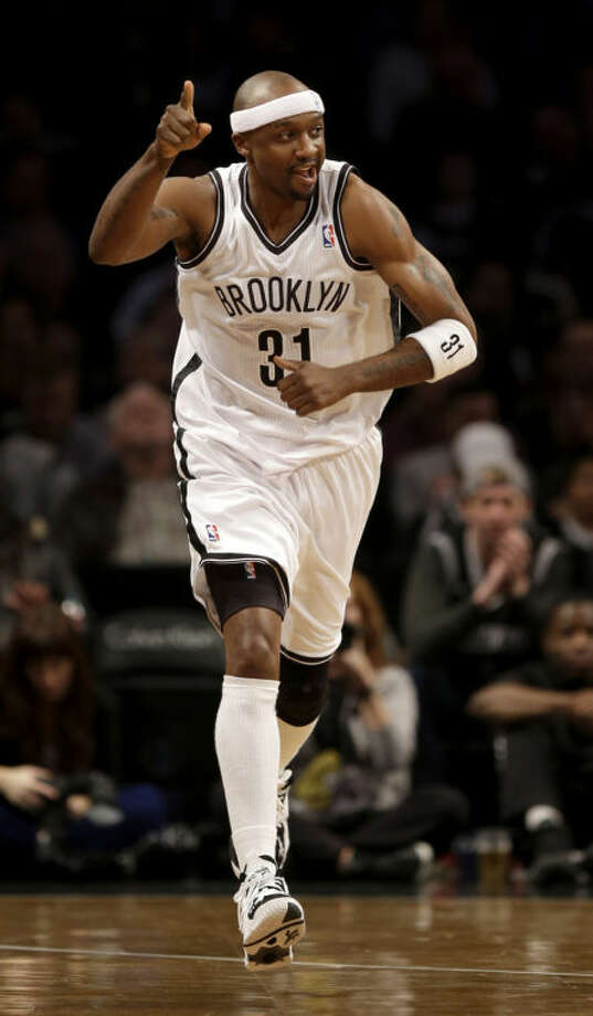 Brooklyn Nets' Jason Terry reacts after scoring during the first half of an NBA basketball game against the Milwaukee Bucks at the Barclays Center, Friday, Dec. 27, 2013, in New York. (AP Photo/Seth Wenig)