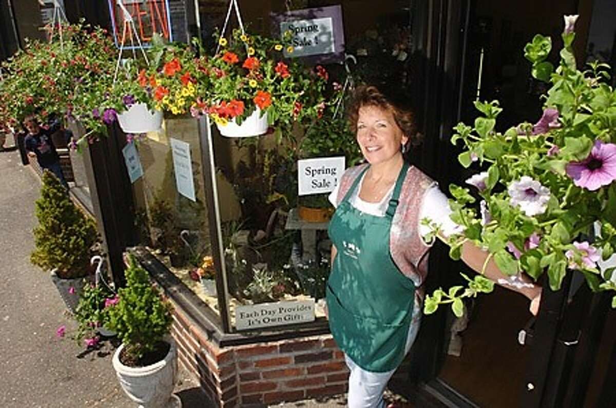 Janet Martino Mercurio is closing her shop,Janet''s Floral Garden after a slow in the economy. Hour photo / Erik Trautmann