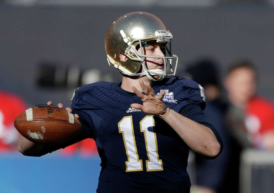 Notre Dame quarterback Tommy Rees throws a pass during the first half of the Pinstripe Bowl NCAA college football game against Rutgers Saturday, Dec. 28, 2013, at Yankee Stadium in New York. (AP Photo/Frank Franklin II) / AP