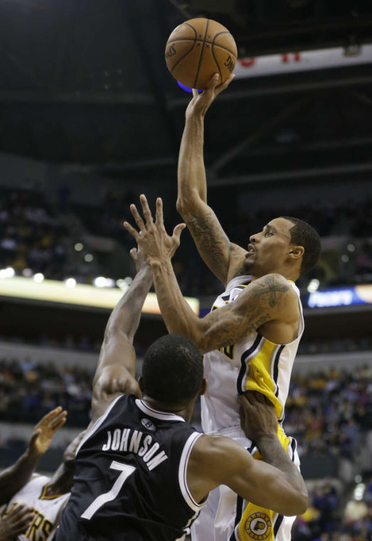 Indiana Pacers' George Hill (3) shoots over Brooklyn Nets' Joe Johnson (7) during the second half of an NBA basketball game Saturday, Dec. 28, 2013, in Indianapolis. Indiana defeated Brooklyn 105-91. (AP Photo/Darron Cummings)
