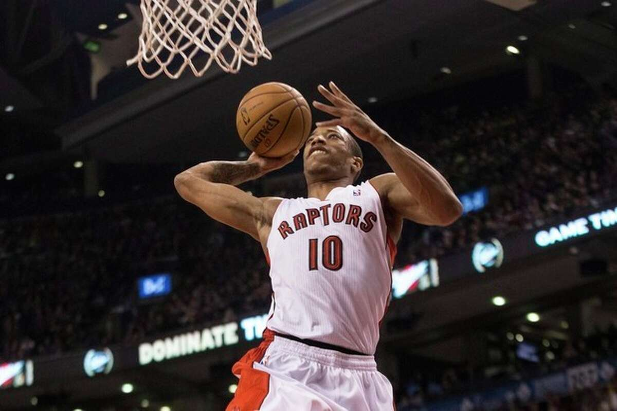Toronto Raptors' DeMar DeRozan scores against the New York Knicks during first-half NBA basketball game action in Toronto, Saturday, Dec. 28, 2013. (AP Photo/The Canadian Press, Chris Young)