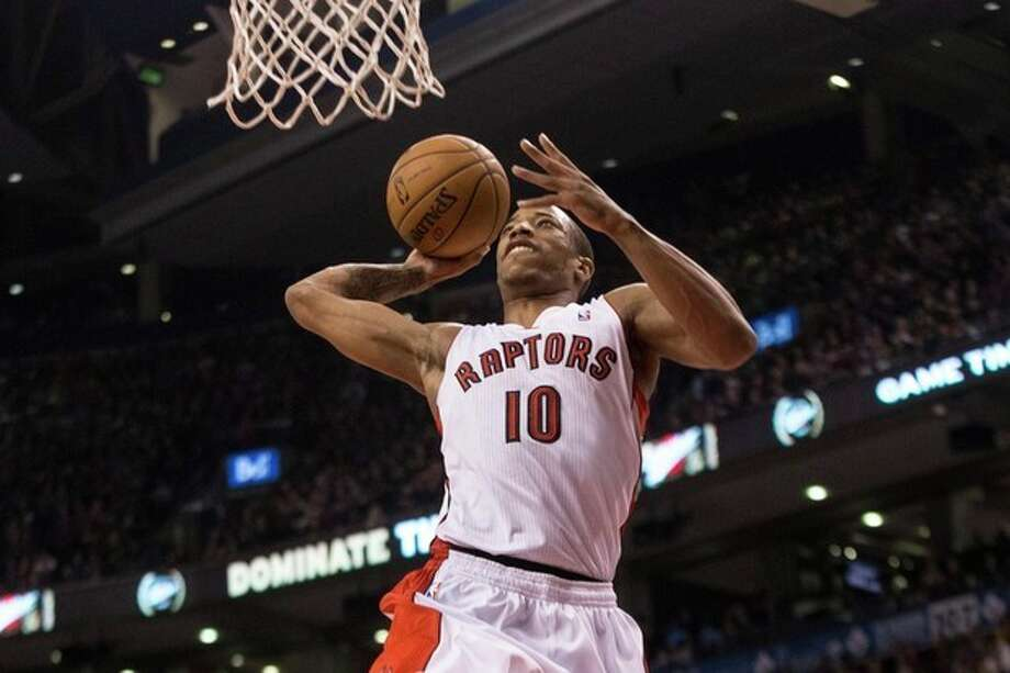 Toronto Raptors' DeMar DeRozan scores against the New York Knicks during first-half NBA basketball game action in Toronto, Saturday, Dec. 28, 2013. (AP Photo/The Canadian Press, Chris Young) / The Canadian Press