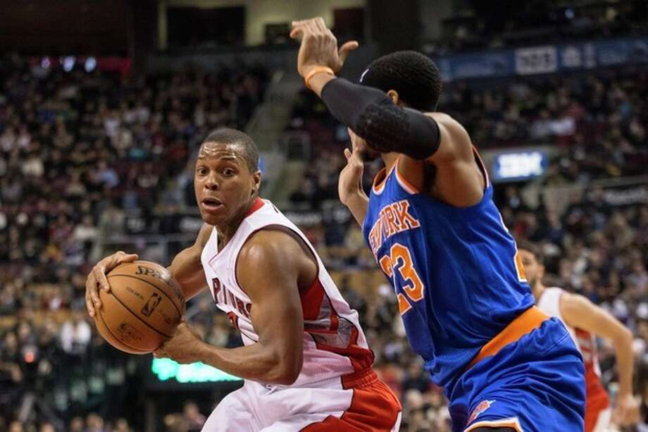 Toronto Raptors' Kyle Lowry, left, drives at New York Knicks' Toure' Murry during first-half NBA basketball game action in Toronto, Saturday, Dec. 28, 2013. (AP Photo/The Canadian Press, Chris Young) / The Canadian Press