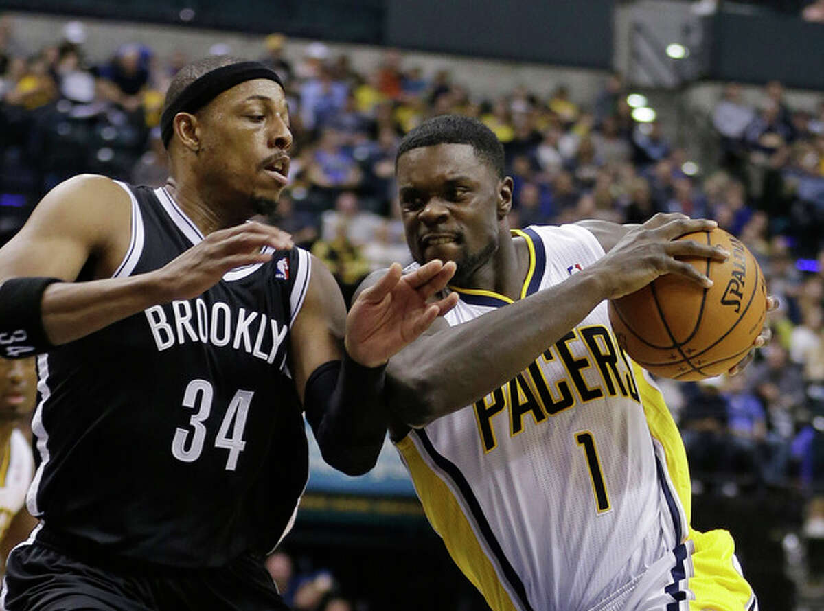 Indiana Pacers' Lance Stephenson (1) goes to the basket against Brooklyn Nets' Paul Pierce (34) during the second half of an NBA basketball game Saturday, Dec. 28, 2013, in Indianapolis. Indiana defeated Brooklyn 105-91. (AP Photo/Darron Cummings)