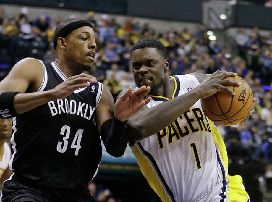Indiana Pacers' Lance Stephenson (1) goes to the basket against Brooklyn Nets' Paul Pierce (34) during the second half of an NBA basketball game Saturday, Dec. 28, 2013, in Indianapolis. Indiana defeated Brooklyn 105-91. (AP Photo/Darron Cummings) / AP
