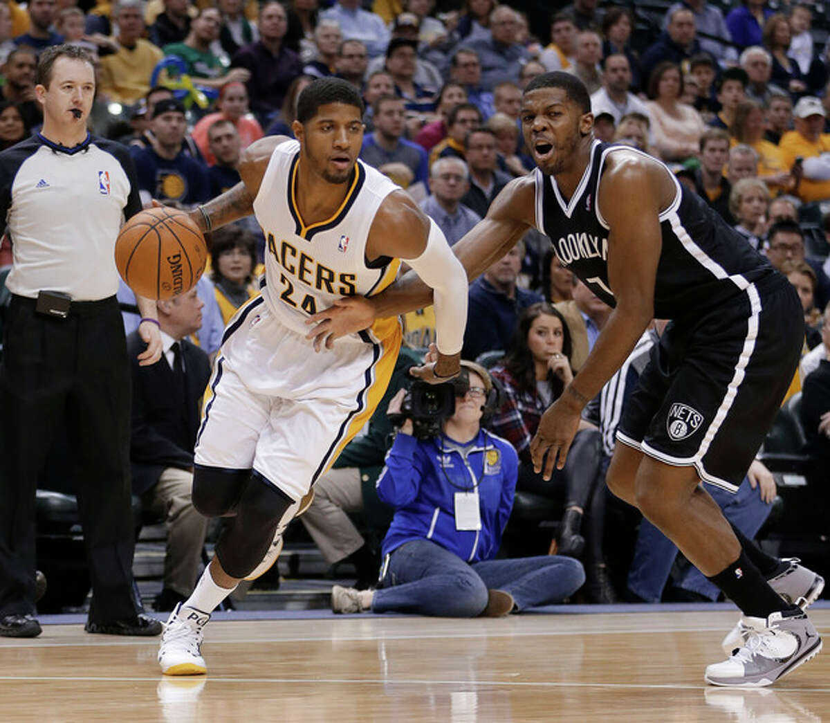 Indiana Pacers' Paul George (24) goes to the basket against Brooklyn Nets' Joe Johnson (7) during the second half of an NBA basketball game Saturday, Dec. 28, 2013, in Indianapolis. Indiana defeated Brooklyn 105-91. (AP Photo/Darron Cummings)