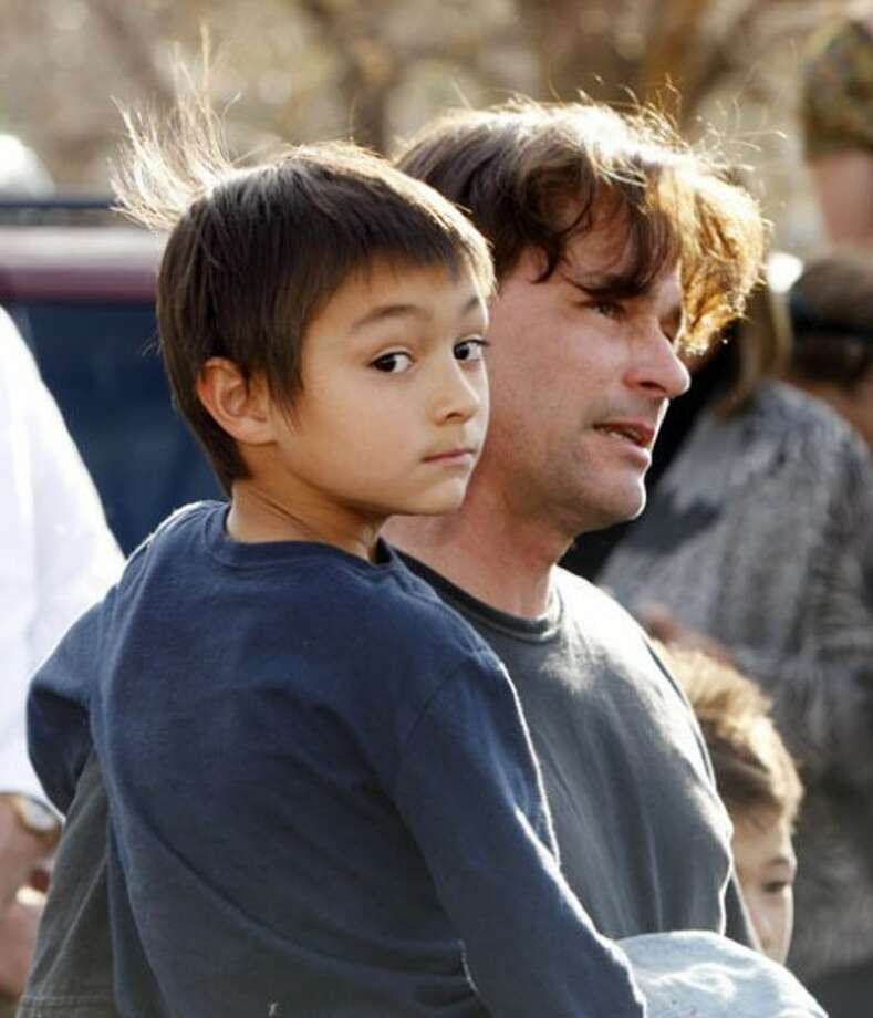 FILE - In this Oct. 15, 2009 file photo, six-year-old Falcon Heene is shown with his father, Richard, outside the family''s home in Fort Collins, Colo., after Falcon Heene was found hiding in a box in a space above the garage. Falcon Heene at first had been reported to be aboard a flying-saucer-shaped balloon fashioned by his father and then carried by high winds on to the plains of eastern Colorado. (AP Photo/David Zalubowski, file)