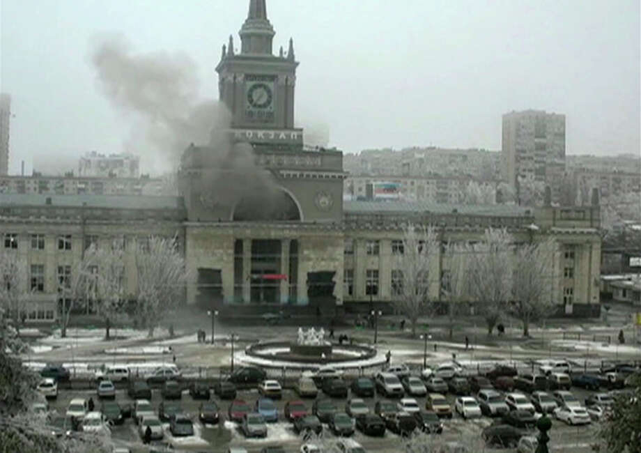 In this photo made by a public camera and made available by the Associated Press Television News smoke pours out after an explosion at Volgograd railway station, in Volograd Russia on Sunday, Dec. 29, 2013. More then a dozen people were killed and scores were wounded Sunday by a suicide bomber at a railway station in southern Russia, officials said, heightening concern about terrorism ahead of February's Olympics in the Black Sea resort of Sochi. (AP Photo/ Associated Press Television News) / Associared Press Television News