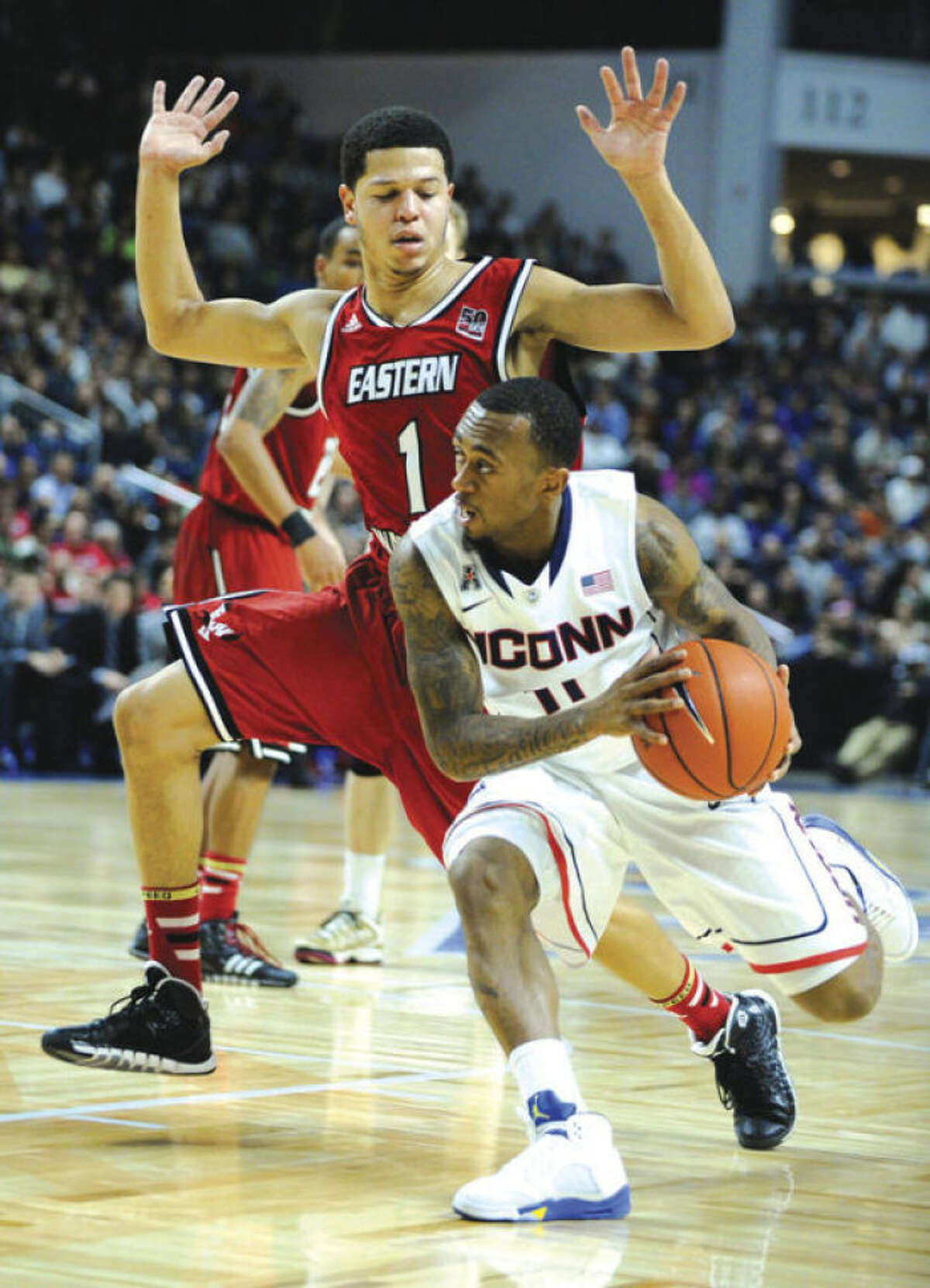 AP photo UConn's Ryan Boatright, right, drives onEastern Washington's Tyler Harvey during Saturday's game.