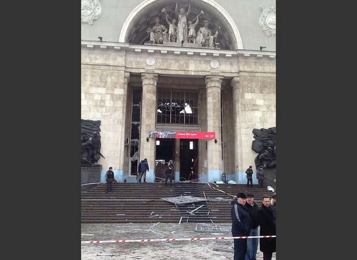 In this photo taken on a cell phone, made available by Volgograd Mayor's Office, debris lies outside an entrance to Volgograd railway station, Sunday, Dec. 29, 2013. More then a dozen people were killed and scores were wounded Sunday by a suicide bomber at a railway station in southern Russia, officials said, heightening concern about terrorism ahead of February's Olympics in the Black Sea resort of Sochi. (AP Photo/Nikita Baryshev,Volgograd Mayor's Office Handout)