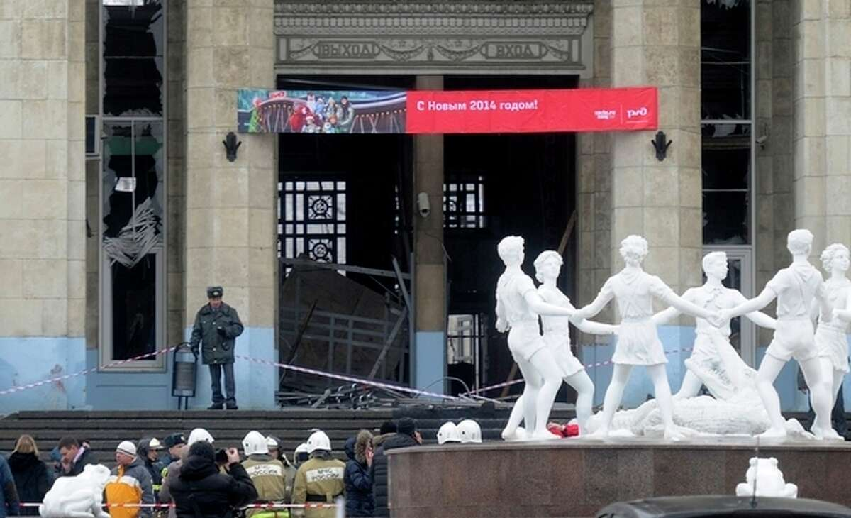AP Photo A police officer guards a main entrance to the Volgograd railway station hit by an explosion, in Volgograd, Russia, Sunday, Dec. 29, 2013. More then a dozen people were killed and scores were wounded Sunday by a female suicide bomber at a railway station in southern Russia, officials said, heightening concern about terrorism ahead of February's Olympics in the Black Sea resort of Sochi.