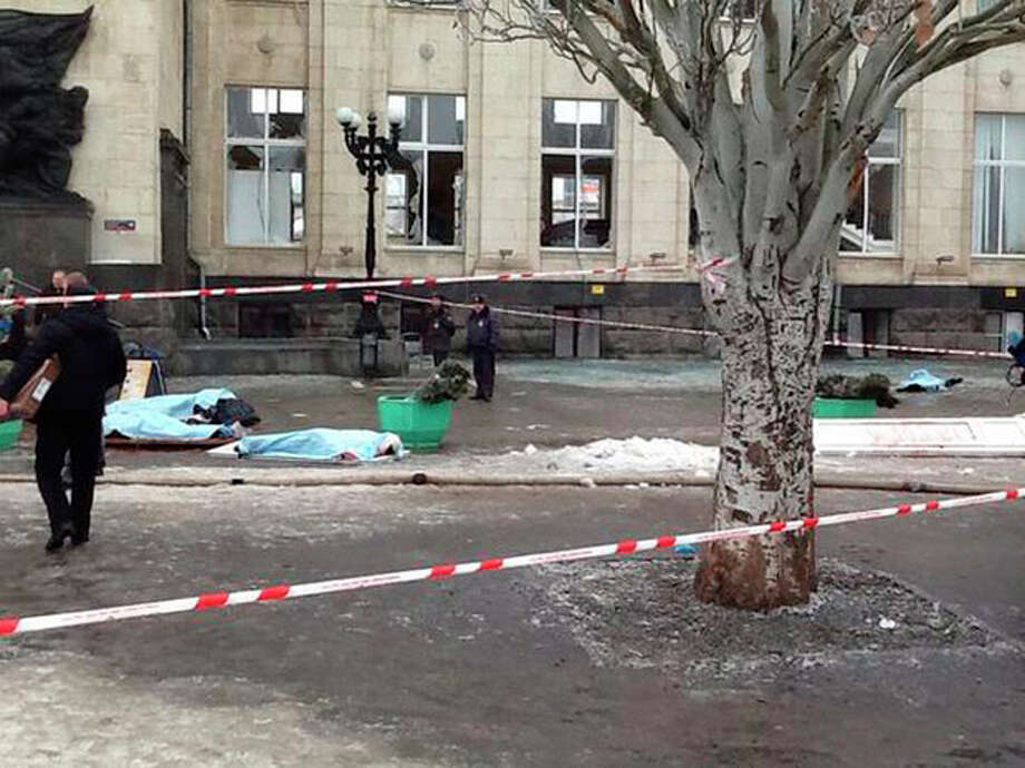 In this photo taken on a cell phone, made available by Volgograd Mayor's Office, bodies lie at an entrance to Volgograd railway station, Sunday, Dec. 29, 2013. More then a dozen people were killed and scores were wounded Sunday by a suicide bomber at a railway station in southern Russia, officials said, heightening concern about terrorism ahead of February's Olympics in the Black Sea resort of Sochi. (AP Photo/Nikita Baryshev,Volgograd Mayor's Office Handout) / Volgograd Mayor's Office Handout/Ria Novosti Kremlin