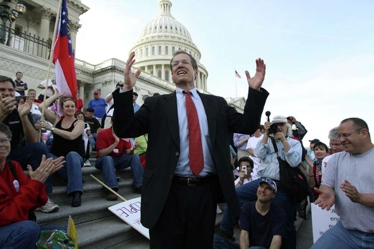 FILE - In this March 20, 2010 file photo, Rep. Jack Kingston, R-Ga., speaks to people demonstrating against the health care bill on the U.S. Capitol steps a day before Congress is set to vote on health care reform on Capitol Hill in Washington. Republicans see the 2014 midterm elections as a chance to capitalize on voter frustration with the problem-plagued health care overhaul, but the GOP first must settle a slate of Senate primaries where conservatives are arguing over the best way to oppose President Barack Obama?'s signature law. Kingston, who wants to succeed retiring GOP Sen. Saxby Chambliss, stepped into the rift recently when he seemed to scold much of his party during an interview on a conservative talk radio show.(AP Photo/Lauren Victoria Burke)