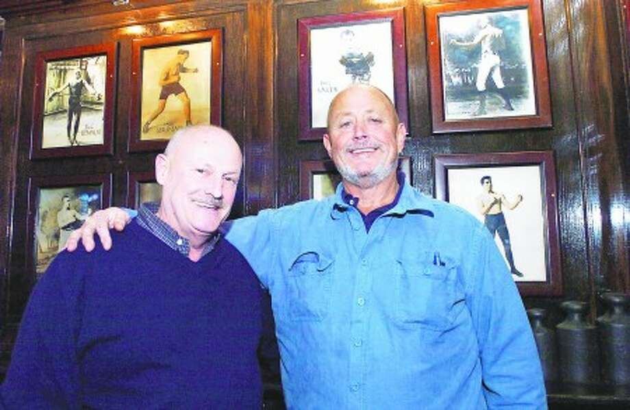"Richard Ball and Paul ""Mac"" Mackenzie take a photo with some of the boxing memorabilia at their restaurant Donovan''s & Mackenzie which opened recently. Hour Photo / Danielle Robinson"