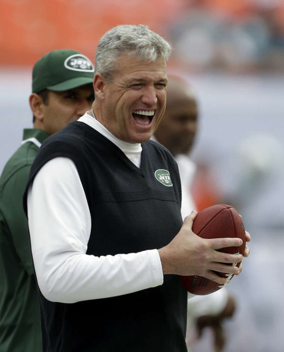 New York Jets head coach Rex Ryan has a laugh on the sideline before an NFL football game against the Miami Dolphins in Miami Gardens, Fla., Sunday, Dec. 29, 2013. (AP Photo/Alan Diaz)