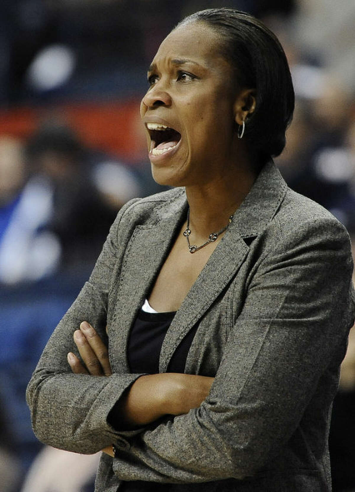 Cincinnati head coach Jamelle Elliot calls out to her team during the first half of an NCAA college basketball game against Connecticut, Sunday, Dec. 29, 2013, in Storrs, Conn. (AP Photo/Jessica Hill)