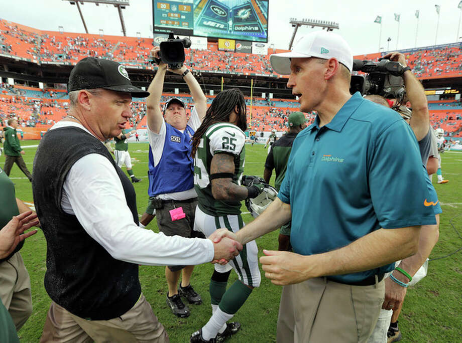 New York Jets head coach Rex Ryan, left, shakes hands with Miami Dolphins head coach Joe Philbin after the Jets defeated the Dolphins 20-7 in an NFL football game Sunday, Dec. 29, 2013, in Miami Gardens, Fla. (AP Photo/Chris O'Meara) / AP