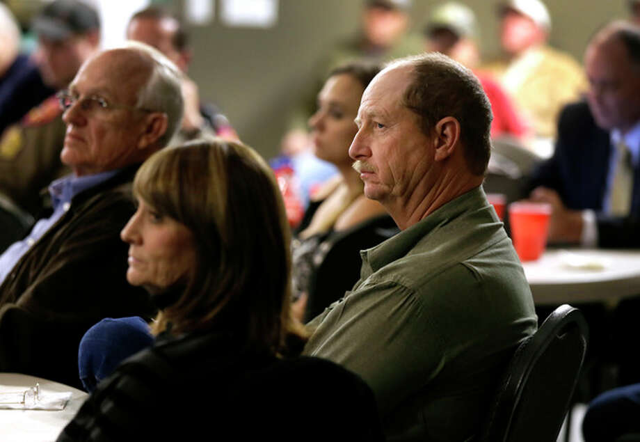 Robert Payne, center right, operator of RPA Associates sits with over 100 first responders and other business owners at a meeting headed by state fire marshal Chris Connealy, Thursday, Dec. 12, 2013, in Clifton, Texas. (AP Photo/Tony Gutierrez) / AP