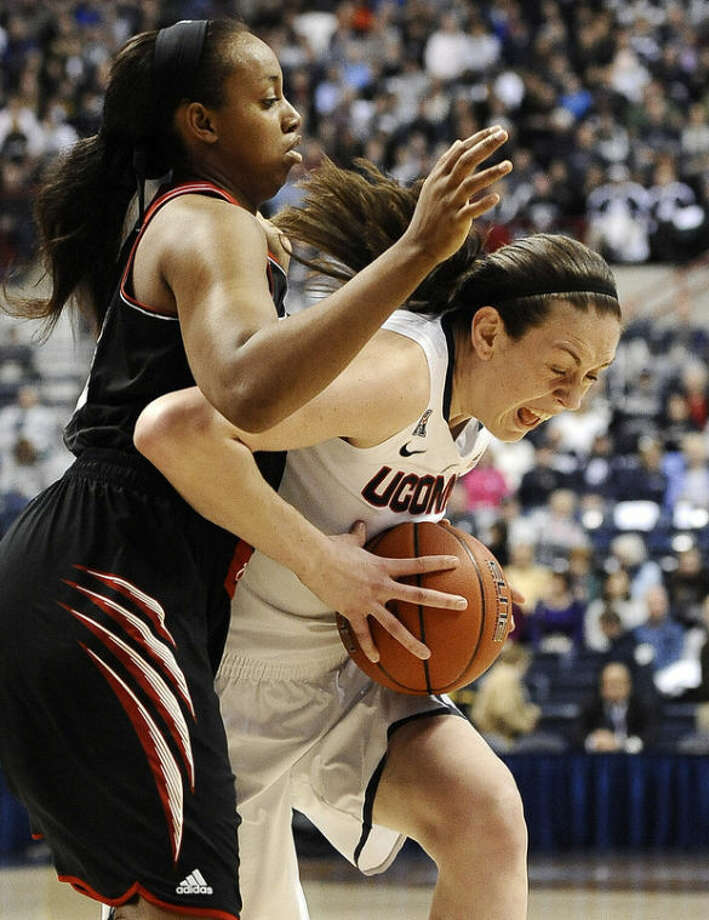 Cincinnati's Jeanise Randolph, left, guards Connecticut's Breanna Stewart, right, during the first half of an NCAA college basketball game on Sunday, Dec. 29, 2013, in Storrs, Conn. (AP Photo/Jessica Hill)