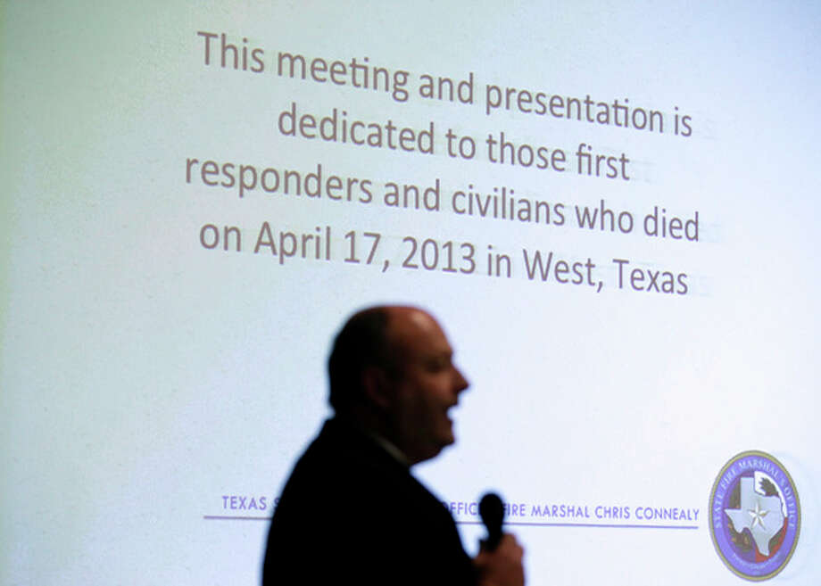 State Fire Marshal Chris Connealy stands in front of a large projections screen as he addresses a group of over 100 first responders, business owners and operators, Thursday, Dec. 12, 2013, in Clifton, Texas. When a fertilizer plant exploded in a small Texas town, killing 15 people and decimating homes and schools, it became Connealy's responsibility to stop anything like it from happening again. (AP Photo/Tony Gutierrez) / AP