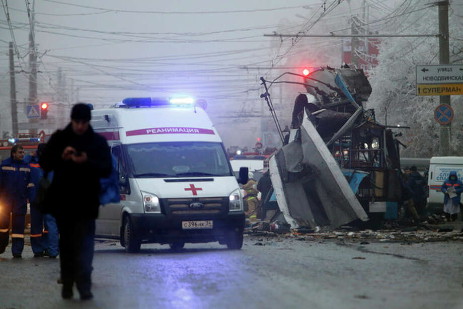 An ambulance leaves the site of a trolleybus explosion in Volgograd, Russia, Monday, Dec. 30, 2013. The explosion left 10 people dead Monday, a day after a suicide bombing that killed at least 17 at the city's main railway. The explosions put the city on edge and highlighted the terrorist threat that Russia is facing as it prepares to host the Winter Games in February. Volgograd is about 650 kilometers (400 miles) northeast of Sochi, where the Olympics are to be held. (AP Photo/Denis Tyrin) / AP