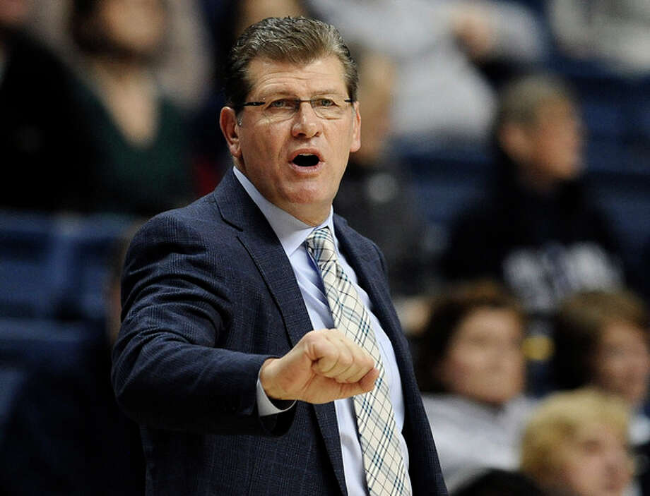 Connecticut head coach Geno Auriemma gestures toward his team during the first half of an NCAA college basketball game against Cincinnati, Sunday, Dec. 29, 2013, in Storrs, Conn. (AP Photo/Jessica Hill) / FR125654 AP